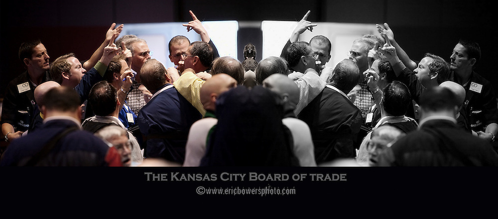 Photos of commodities and futures trading and the support staffs employed in the business at the Kansas City Board of Trade. <br />
