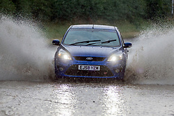 © Licensed to London News Pictures. 26/07/2018. Garton on the wolds UK. Heavy thunderstorms have hit Yorkshire this evening causing roads to flood in Garton-on-the-wolds. Photo credit: Andrew McCaren/LNP