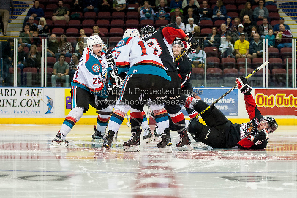 KELOWNA, CANADA - SEPTEMBER 5: Cole Linaker #26 and Rodney Southam #17 of Kelowna Rockets dig for the puck after the face off against the Prince George Cougars on September 5, 2015 during the first pre-season game at Prospera Place in Kelowna, British Columbia, Canada.  (Photo by Marissa Baecker/Shoot the Breeze)  *** Local Caption *** Cole Linaker; Rodney Southam;