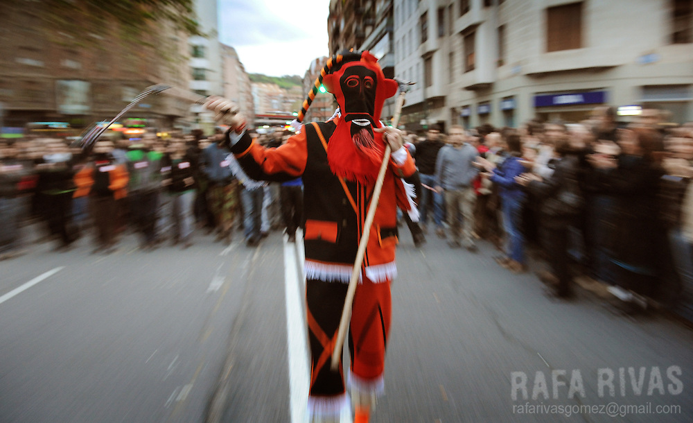 A Basque traditional dancer heads a demonstration, followed by thousands of people marching in the northern Spanish Basque city of Bilbao in protest of detention of 36 members of SEGI, on November 28, 2009. Spanish police, on November 24, detained 36 members of Segi, an outlawed youth group believed to have ties to the armed Basque separatist group ETA, during an anti-terrorist operation, in the Basque Country and neighboring Navarra ordered by Spanish Judge Grande Marlaska. PHOTO/Rafa Rivas