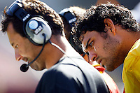 21 August 2008: Injured QB quarterback #6 Mark Sanchez reads plays from coach Steve Sarkisian on the sidelines during the USC Trojans Pac-10 NCAA College football team final intrasquad scrimmage of fall camp in front of 8,000 fans in the Los Angeles Memorial Coliseum near school campus.  White team (1st and 2nd teamers) defeated the Cardinal (reserves) team 28-7 on Thursday.