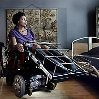 Nederland, Amsterdam , 4 juni 2014.<br /> Carla Vriesde.<br /> Zij is een ernstig zieke rolstoelafhankelijke vrouw die al drie maanden op bed ligt omdat haar rolstoel (door bureaucratische rompslomp) maar niet wordt aangepast.<br /> Inmiddels op de foto heeft zij zojuist de aangepase rolstoel gekregen, waar nog enkele aanpassingen moeten worden toegevoegd.<br /> Foto:Jean-Pierre Jans