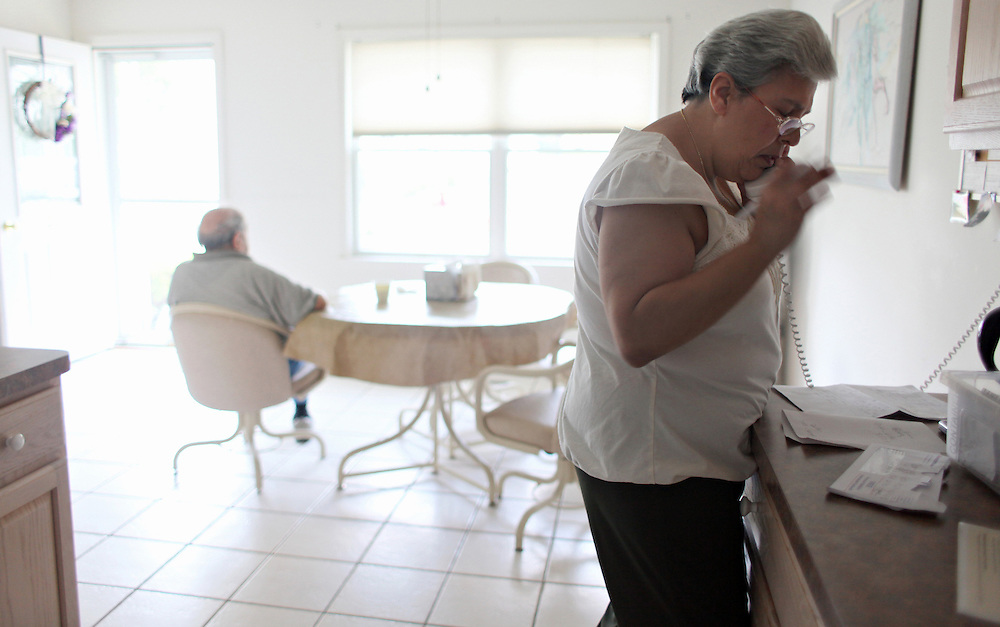 Xavier Mascareñas/The Journal News; Nancy Siragusa, 48, makes calls to try and procure a lightly-used wheelchair for her mother after setting her down to watch television July 7, 2010.