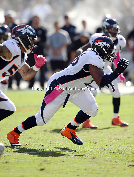 Denver Broncos defensive end Vance Walker (96) rushes the quarterback during the 2015 NFL week 5 regular season football game against the Oakland Raiders on Sunday, Oct. 11, 2015 in Oakland, Calif. The Broncos won the game 16-10. (©Paul Anthony Spinelli)