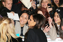 © Licensed to London News Pictures. Victoria Beckham poses for photographs with fans as she attends The Class of 92  World Film Premiere at The Odeon West End, Leicester Square, London on 01 December 2013. Photo credit: Richard Goldschmidt/LNP