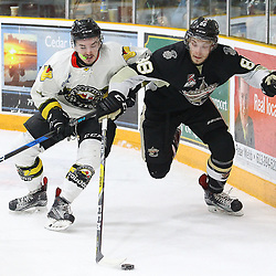 "TRENTON, ON  - MAY 2,  2017: Canadian Junior Hockey League, Central Canadian Jr. ""A"" Championship. The Dudley Hewitt Cup Game 2 between Trenton Golden Hawks and Powassan Voodoos.    Shane Beaulieu #7 of the Powassan Voodoos and Michael Silveri #88 of the Trenton Golden Hawks fight for the puck during the first period<br /> (Photo by Alex D'Addese / OJHL Images)"