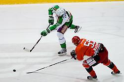 Igor Cvetek (HDD Tilia Olimpija, #4) vs Johan Björk (HK Acroni Jesenice, #55) during of ice-hockey match between HK Acroni Jesenice and HDD Tilia Olimpija in 13th Round of EBEL league, on October 21, 2011 at Hala Tivoli, Ljubljana, Slovenia. (Photo By Matic Klansek Velej / Sportida)