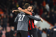 Asmir Begovic (27) of AFC Bournemouth and Steve Cook (3) of AFC Bournemouth hug at full time after a 2-1 win over Huddersfield during the Premier League match between Bournemouth and Huddersfield Town at the Vitality Stadium, Bournemouth, England on 4 December 2018.
