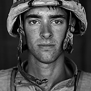 U.S. Marine Sgt. Eric Peterson age 22 who is part of Alpha Company of the 24th Marine Expeditionary Unit (MEU) Battle Landing Team (BLT) 1/6, after a patrol in Garmsir District, Helmand Province, Afghanistan at Forward Operating Base Apache North. Located in Southern Helmand Province, Garmsir has been a haven for insurgents for the last several years. Earlier this year the Marines cleared the area after a period of heavy fighting. Eric is from Mentor OH and he has also done a tour of Iraq in addition to this tour.