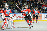 KELOWNA, CANADA, OCTOBER 26: Adam Brown #1 defends the net while Madison Bowey #4 of the Kelowna Rockets skates on the ice as the Prince George Cougars visit the Kelowna Rockets  on October 26, 2011 at Prospera Place in Kelowna, British Columbia, Canada (Photo by Marissa Baecker/Shoot the Breeze) *** Local Caption *** Madison Bowey; Adam Brown;