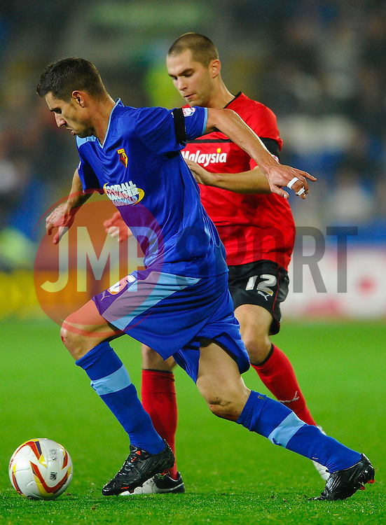 Watford Forward Alexandre Geijo (SUI) vies with Cardiff Defender Matthew Connolly (ENG) during the first half of the match - Photo mandatory by-line: Rogan Thomson/JMP - Tel: Mobile: 07966 386802 23/10/2012 - SPORT - FOOTBALL - Cardiff City Stadium - Cardiff. Cardiff City v Watford - Football League Championship