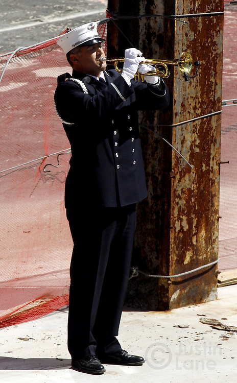 A New York City Fire Department bugler plays taps at the edge of the World Trade Center site at the close of the September 11th commemoration ceremony in New York on Monday 11 September 2006. This year marks the five year anniversary of the attacks. ..