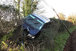 © Licensed to London News Pictures. 14/01/2014. East Hamptree, UK There were a number of Car accidents caused by ice in Somerset today , this vehicle left the road at East Harptree, destroying a Telegraph Pole<br /> . Photo credit : Jason Bryant/LNP