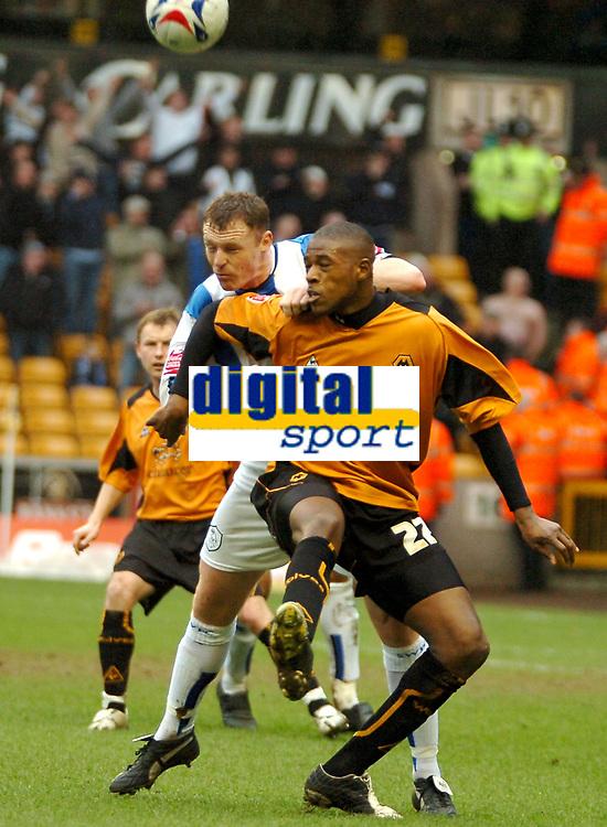 Photo: Ed Godden.<br />Wolverhampton Wanderers v Sheffield Wednesday. Coca Cola Championship. 25/03/2006. <br />Wednesday's Graham Coughlan (L) and Carl Cort battle.