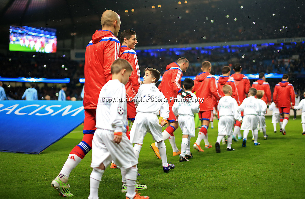 25th November 2014 - UEFA Champions League - Group E - Manchester City v Bayern Munich - A young mascot looks back at Arjen Robben of Bayern as he walks out with the players - Photo: Simon Stacpoole / Offside.