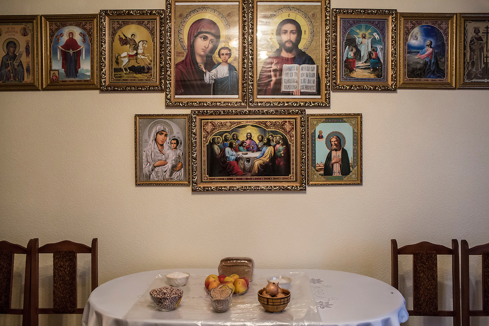 Traditional lenten dishes are placed on a table under religious icons before the start of the Malanka Festival on Wednesday, January 13, 2016 in Krasnoilsk, Ukraine.