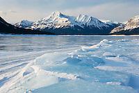 Sunrise over the wind blasted surface of Abraham Lake, Alberta Canada