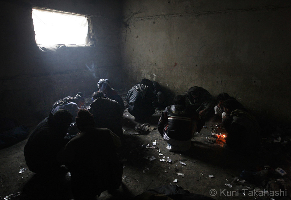 Men smoke and inject heroin in an abandoned building in Kabul, Afghanistan on Nov 14, 2008. According to the United Nations, illegal drug addiction rates in Afghanistan have doubled in the past two years. Nearly a million people are believed to be using illegal drugs, including more than 150,000 opium users and 50,000 heroin addicts.