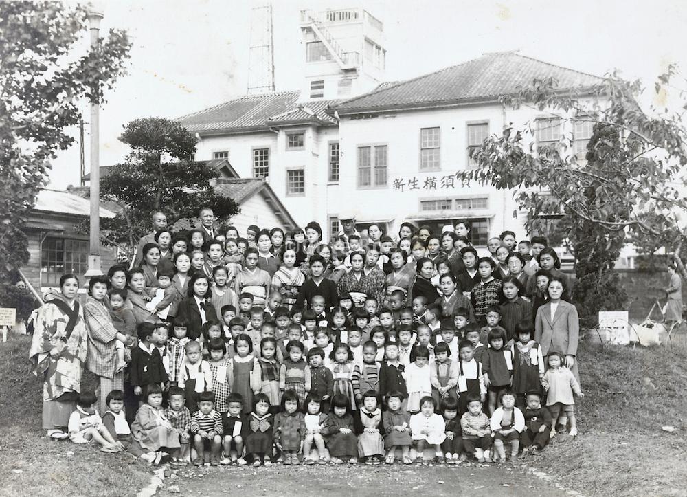 formal group portrait of the kindergarten with parents Yokosuka Japan late 1940s