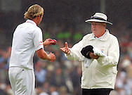Photo © ANDREW FOSKER / SPORTZPICS 2008 - Umpire Steve Davis takes the match ball in exchange for Stuart Broad 's cap and sweater in steady drizzle as they take an early lunch at the Oval as rain stops play  - England v South Africa - 09/08/08 - Fourth nPower Test Match -  Day 3 - The Brit Oval - London - UK - All rights reserved