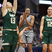 HARTFORD, CONNECTICUT- JANUARY 10: Napheesa Collier #24 of the Connecticut Huskies celebrates a basket by team mate Gabby Williams #15 of the Connecticut Huskies as Dorottya Nagy #13 of the South Florida Bulls and Maria Jespersen #12 of the South Florida Bulls stand dejected during the the UConn Huskies Vs USF Bulls, NCAA Women's Basketball game on January 10th, 2017 at the XL Center, Hartford, Connecticut. (Photo by Tim Clayton/Corbis via Getty Images)