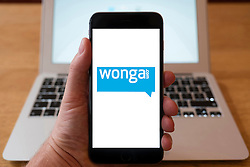 Using iPhone smartphone to display logo of Wonga.com the payday lending company