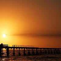 Sunset behind Swakopmund Pier