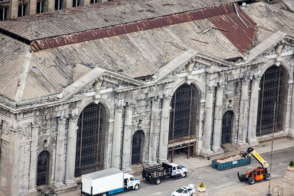 The crumbling facade of Michigan Cetnral Station. Designed by architecture firms Warren & Wetmore and Reed & Stem (also designers of New York's Grand Central Station), it is an example of Beaux-Arts Classical style architecture. The building is 500,000 square feet and was worth $15 million when it was built between 1912 and 1913.