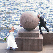 Newlyweds posing for photos on the<br /> Strelka, St. Petersburg, Russia<br /> c. Ellen Rooney