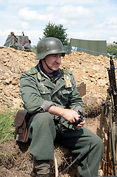 German Soldier sits on the edge of a trench during the Ponderosa Wartime Weekend.<br /> 9th July 2011.<br /> Images &copy; Paul David Drabble