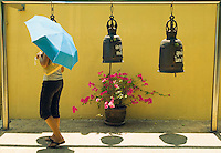 Woman with umbrella at Golden Mount Wat Saket Bangkok Thailand&#xA;<br />