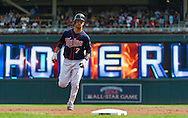 Joe Mauer #7 of the Minnesota Twins rounds the bases after hitting a home run during a game against the Chicago White Sox on September 16, 2012 at Target Field in Minneapolis, Minnesota.  The White Sox defeated the Twins 9 to 2.  Photo: Ben Krause