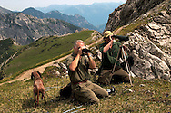 Liechtenstein  Malbun  June 2008.Small town high in the Alpine (southeastern)..Fürstin-Gina-Weg' (Princess Gina memorial trail).Two men observe some animals in the background Alps..