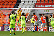 Blackpool keeper Sam Slocombe gets up high to clear with a punch during the EFL Sky Bet League 2 match between Blackpool and Exeter City at Bloomfield Road, Blackpool, England on 6 August 2016. Photo by Craig Galloway.