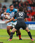 Christian Loamanu holds off a challenge from David Skrela. Stade Toulousain v Toulon, 11eme Journee, Top 14, Stade Ernest Wallon, Toulouse, France, 30th October 2010.