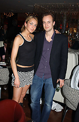 The MARQUESS OF BRISTOL and his sister LADY ISABELLA HERVEY at a night of Cuban Cocktails and Cabaret hosted by Edward Taylor and Charles Beamish at Floridita, 100 Wardour Street, London W1 on 14th April 2005.<br />