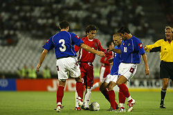 BELGRADE, SERBIA & MONTENEGRO - Wednesday, August 20, 2003: Three Serbia & Montenegro players prevent Wales' Simon Davies from tacking a quick free-kick during the UEFA European Championship qualifying match at the Red Star Stadium. (Pic by David Rawcliffe/Propaganda)