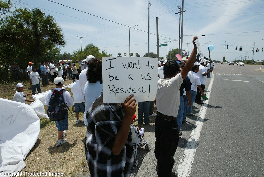 An illegal immigrant is afraid to show his face but still wants to get his message out during a march for immigrant rights in Wimauma, Florida