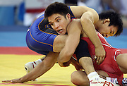 Henry Cejudo (red) of the USA wrestles Tomohiro Matsunaga of Japan with in the Men's freestyle wrestling event at the Beijing Olympics, Tuesday Aug. 19, 2008.Natalie Behring/Bloomberg News