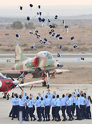 Pilots of Class 165 of Israeli Air Force s (IAF) Flight School throw their hats up to the air as they celebrate their graduation at IAF s Hatzerim base near Beersheva, south Israel, December 27, 2012. Photo by Imago / i-Images...UK ONLY