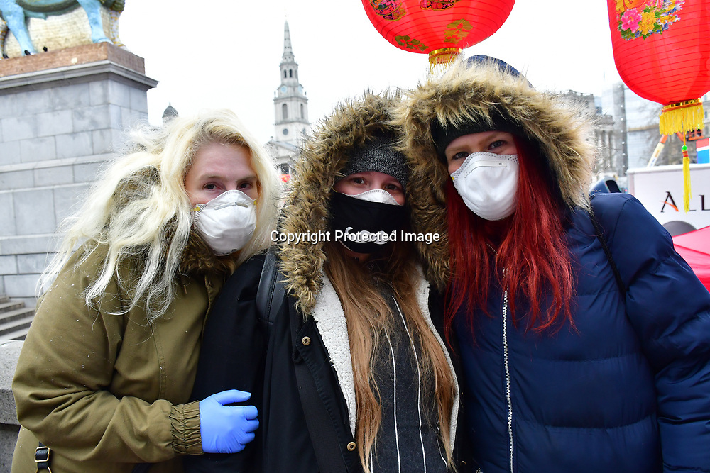 Three English girls wearing mask say they scare of Coronavirus of Wuhan threat in Trafalgar Square, At the mean time in US this season killed more 4800 people of Flu symptoms and they no outcry. Centers for Disease Control and Pervention, Dr Robert Redfield Say, Wuhan virus and common flu virus both are #coronavirus And i don't think the Western media scaremonger is about corona virus more of a hate anti-China on 25th January 2020,London, UK.