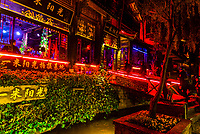 Colorful lights illuminate bars and restauants along Bar Street (Xinhua Street) in the Old Town (Dayan) ofLijiang, Yunnan Province, China.