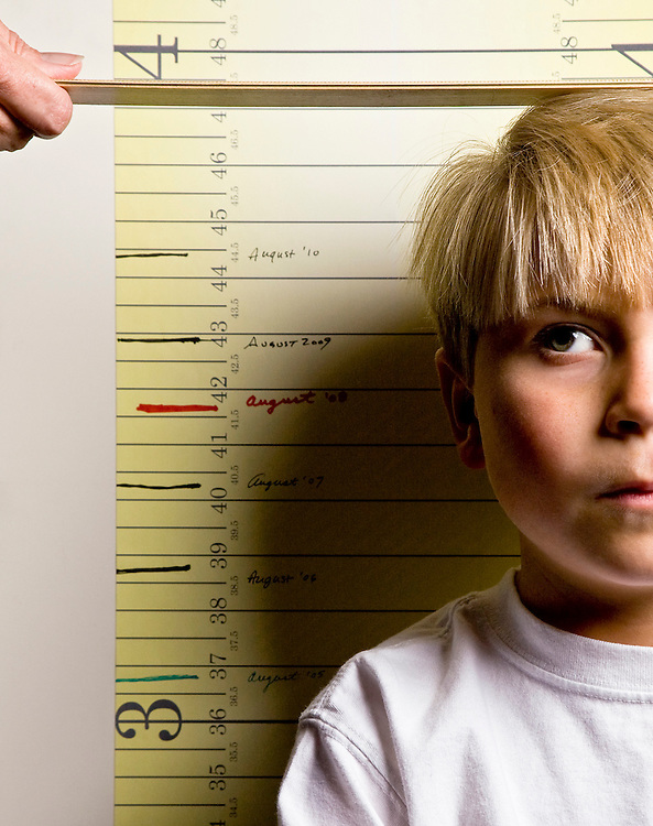 image of a young boy's height being measured