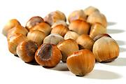 Close up of hazelnuts on white background