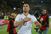 Lukas Podolski of Germany pats the crest on his shirt to the fans during the International Friendly match between Germany and England at Signal Iduna Park, Dortmund, Germany on 22 March 2017. Photo by Phil Duncan.