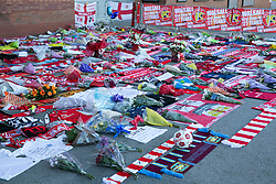 © Licensed to London News Pictures. 30_06_2015. Walsall, West Midlands, UK. The scene at Bescot Stadium, Walsall Football ground earlier today as tributes to Patrick Evans, Adrian Evans and Joel Richards, killed in Tunisia, were laid out. Photo credit : Dave Warren/LNP