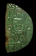 Jade pendant of the young maize god and a jade pendant Maya.  AD 400-800.  Maize tassels frame the image of the god, the river of life.