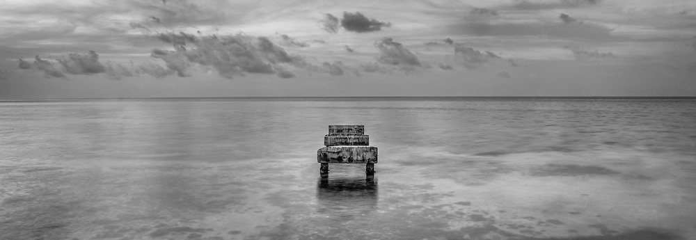 The remains of an old pier at Smathers Beach, Key West.