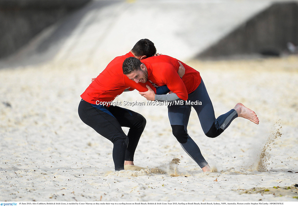 15 June 2013; Alex Cuthbert, British & Irish Lions, is tackled by Conor Murray as they make their way to a surfing lesson on Bondi Beach. British & Irish Lions Tour 2013, Surfing at Bondi Beach, Bondi Beach, Sydney, NSW, Australia. Picture credit: Stephen McCarthy / SPORTSFILE