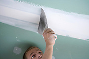 adding plaster to a drywall ceiling